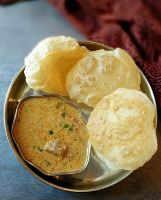 Bhatura with Meka Mamsam